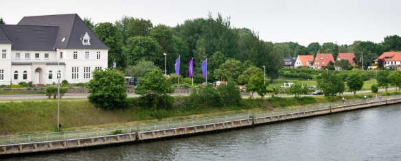 A hotel and homes along the side of the Kiel Canal, Germany