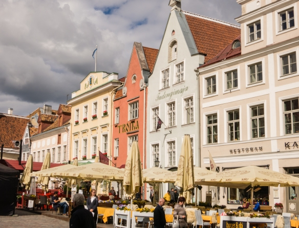 A long row of shops and cafes along one side of Raekoja Plats (Town Hall square), Tallinn, Estonia
