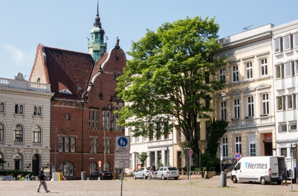 A public square near the Heiligen-Geist-Hospital (Hospital of the Holy Spirit) with buildings from three centuiries – the 18th, 19th, and 20th, Lübeck, Germany
