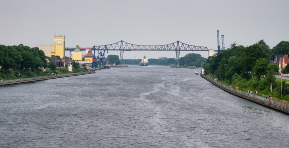 A railroad bridge, one of several crossings of the canal (the automobile-truck bridges are free), Kiel Canal, Germany