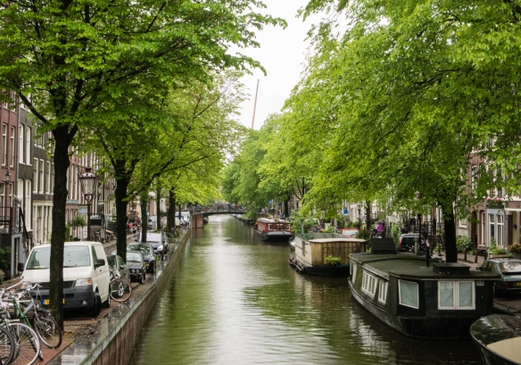 A typical canal, with several houseboats, in the Jordaan Quarter, originally built in the 17th century to house an influx of immigrants, Amsterdam, Netherlands