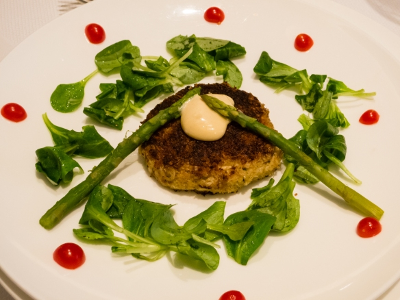An appetizer of homemade crab cakes, asparagus, mache and tomatoes for a dinner party in our apartment on the ship for friends while transiting the Kiel Canal, Germany