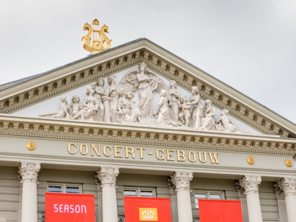 Close-up of the music inspired, Greek-style pediment (and rooftop harp) of the Royal Concertgebouw Orchestra House, Amsterdam, Netherlands
