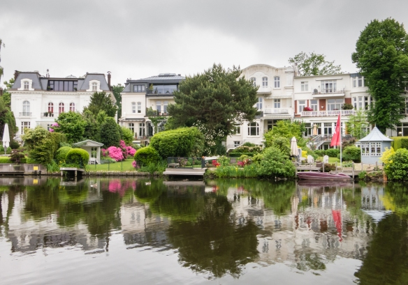 Luxurious homes (mansions) on a small pond off one of the numerous canals in the district northeast of Aussenalster (Outer, and larger, Alster) Lake, Hamburg, Germany