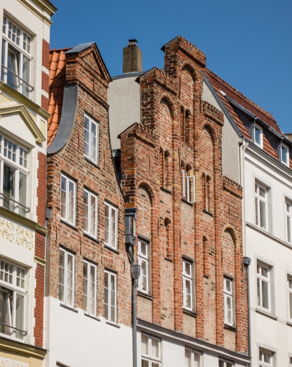 Note the three-tiered, top façade of one of the buildings is strictly decorative, in front of a very steep A-frame roof in Altstadt (old town) Lübeck, Germany
