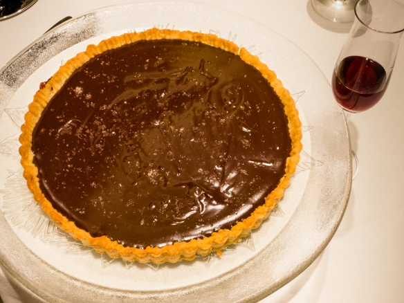 The dessert was a chocolate-caramel tarte based on a Parisian family recipe from our friend, Paule, for a dinner party in our apartment on the ship for friends while transiting the Kiel Canal, Germany