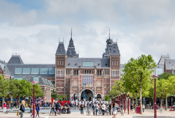 "The front entrance to the Rijksmuseum, just beyond the modern, iconic ""I amsterdam"" white and red ""letter"" sculpture at the northern edge of the Museumplein, Amsterdam, Netherlands"