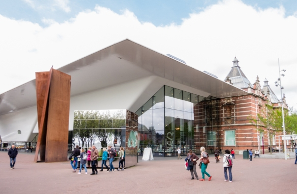 The very modern architecture extension to the Stedelijk Museum of modern art, with the original museum building (founded in 1874) on the right rear side of the photograph, Museumplein, Amsterdam, Netherlands
