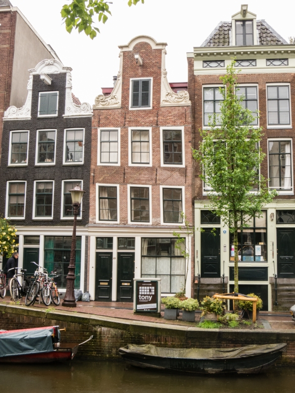 Typical 17th century homes along a canal in the Jordaan Quarter, Amsterdam, Netherlands