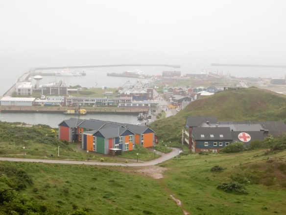View of the commercial district along the eastern waterfront in the Unterland (lowerland) section of town, photographed from the Oberland (upper land) section of the city, Helgoland, Germany