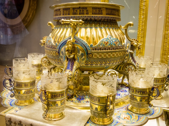 A highly decorated Russian Samovar and tea cups owned by the Romanovs, Fabergé Museum, St. Petersburg, Russia