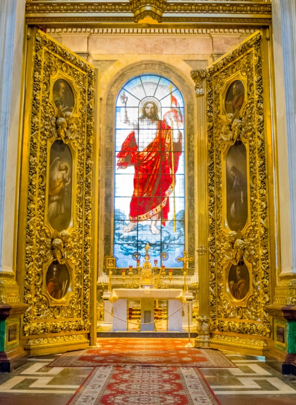 "A large, brightly colored stained glass window of the ""Resurrected Christ"" takes pride of place inside the main altar, Saint Isaac's Cathedral or Isaakievskiy Sobor, St. Petersburg, Russia"