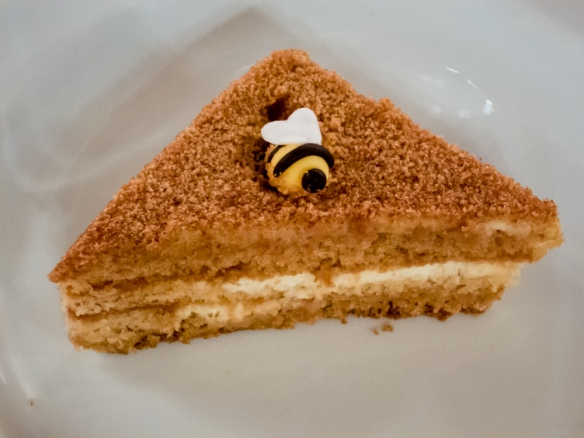 Dessert of honey cake with each slice having its own marzipan honey bee, Podvoyre (Dacha Terem) Restaurant, St. Petersburg, Russia