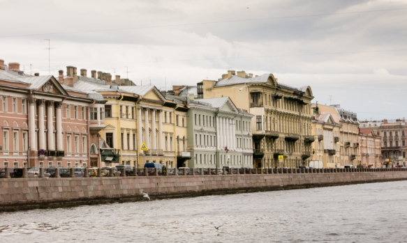 From their exteriors, it is nearly impossible at a distance from the canal boat to correctly guess what the condition inside and use of a particular building is, St. Petersburg, Russia