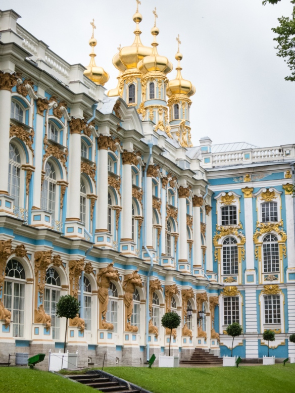 Gilded Russian onion domes and façade of Catherine's Palace, St. Petersburg, Russia -- In Elizabeth's reign it took over 100 kg of gold to decorate the palace exteriors, an excess that was later deplored by Catherine the Great