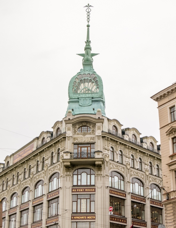 Having been founded only in 1703, St. Petersburg, Russia, drew heavily on European culture, style, architecture, dress, music and the arts; this 1907 building has French writing on it and precursors the Art Deco style