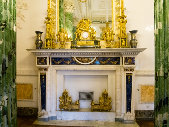 Malachite columns and a highly decorated fireplace (and a mantle full of golden staues and clock), Pavlosk Palace, St. Petersburg, Russia