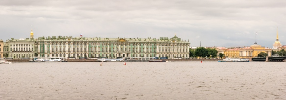 Panorama along the Neva River with the Winter Palace (Hermitage museum) (center and left) and the Admiralty (right) – a UNESCO World Heritage Site -- St. Petersburg, Russia