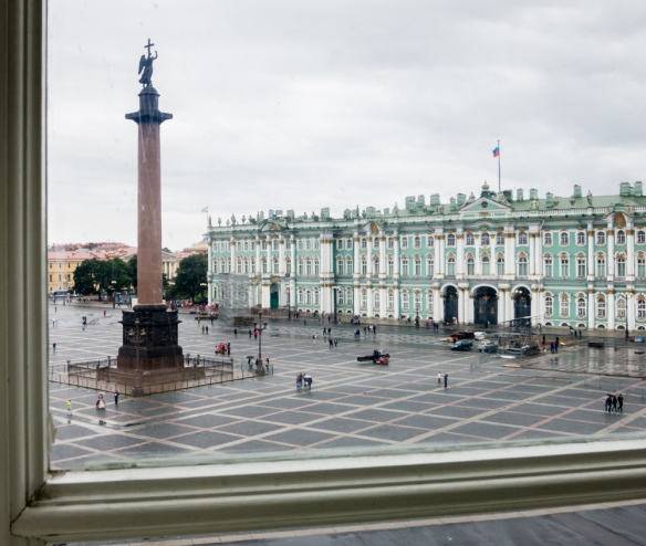 The Alexander Column in Palace Square (viewed from the new Hermitage galleries) is a monument to the Russian military victory in the war with Napoleon's France, named after Emperor Alexander I, St. Petersburg, Russia