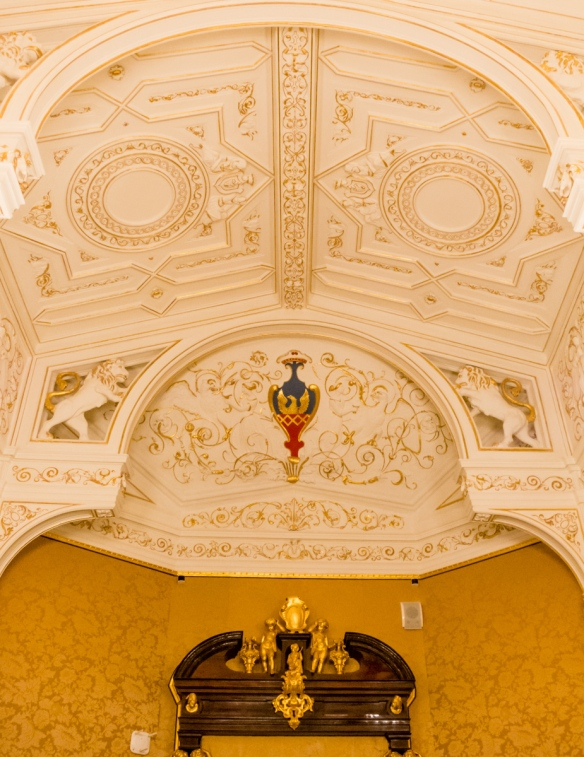 The elaborate, gilded ceiling of one of the current exhibition rooms in the extensively restored Shuvalov Palace, Fabergé Museum, St. Petersburg, Russia