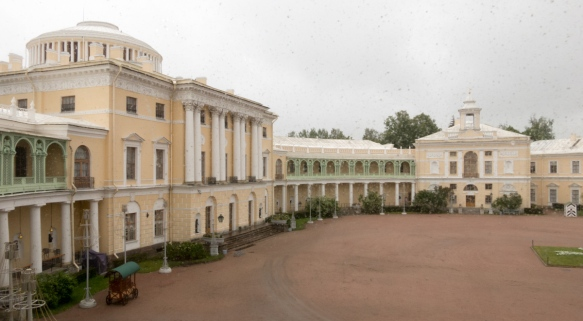 The front entrance (left, center) of Pavlosk Palace, St. Petersburg, Russia, viewed through a heavy rain from one of the rooms inside the palace