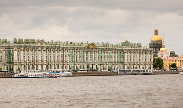 The Winter Palace (home of the Hermitage museum) on the Neva River, with the Admiralty on the right and the gold dome of St. Isaac's Cathedral in the right background, St. Petersburg, Russia