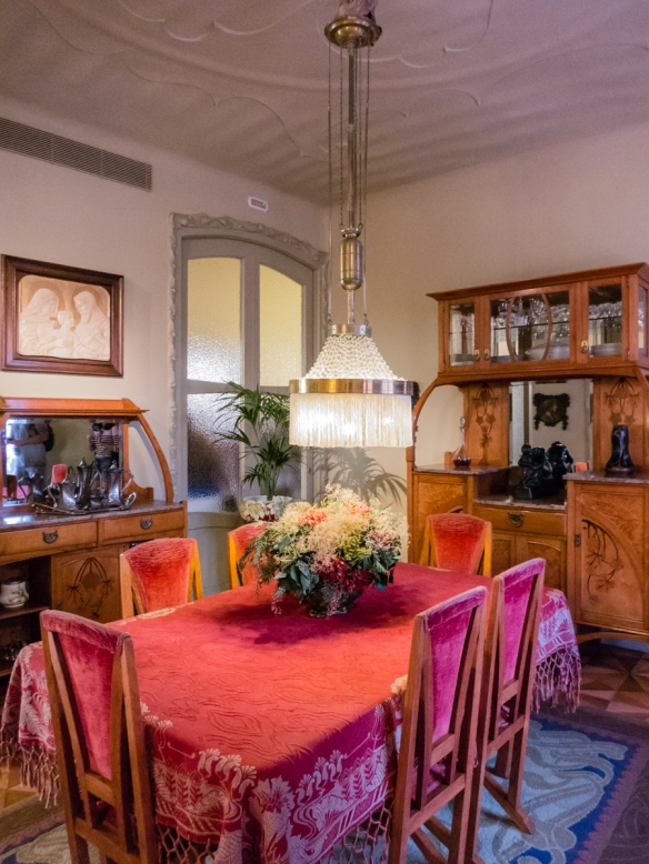 A dining room with period furniture in an apartment on the fourth floor of Casa Milà (La Pedrera), part of a recreation of the home and lifestyle of a bourgeois family in the early 20th century, Barcelona, Spain