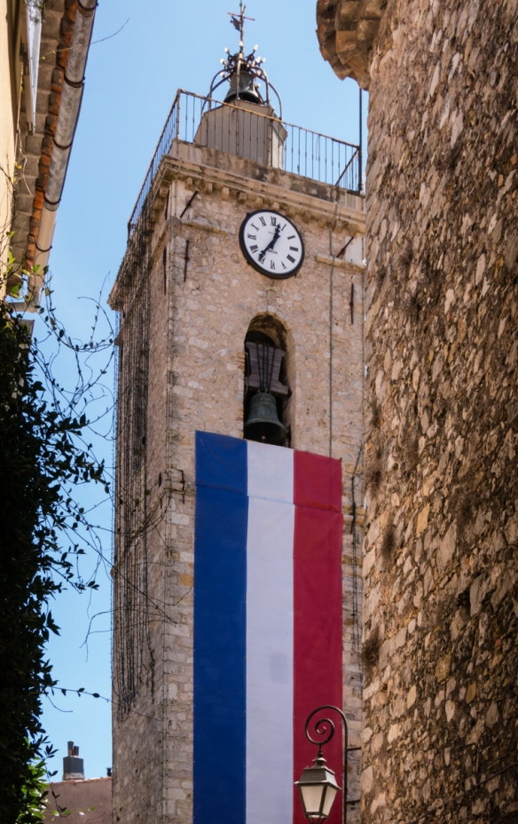 An unusual decoration on the side of a church – the French tricolor, Mougins, France