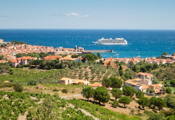 As Le Petit Train (the little train) climbed up the hill between Collioure and Port-Vendres, France, we had an excellent view through the vineyards of our ship anchored just outside of Collioure port
