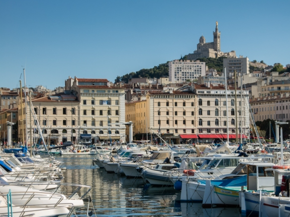 Basilique Notre-Dame da la Garde (Our Lady of the Guard Basilica) sits atop a hill overlooking the Vieux Port (Old Port) of Marseille, France