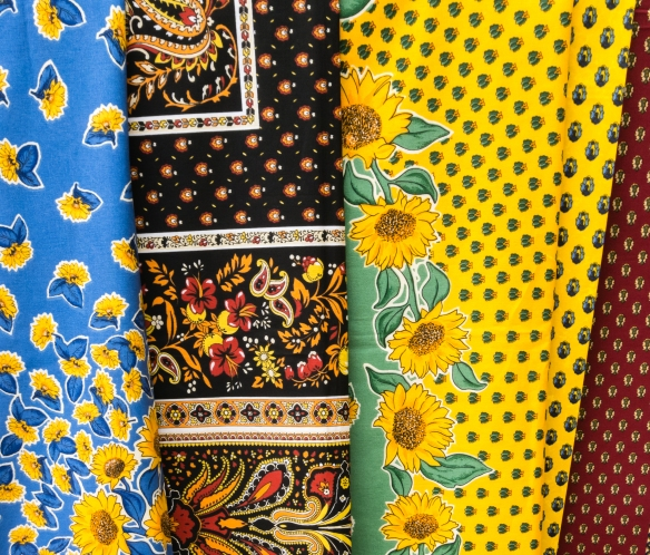 Brightly colored Provencal fabrics for sale at the market on Cours Mirabeau, Aix-en-Provence, France