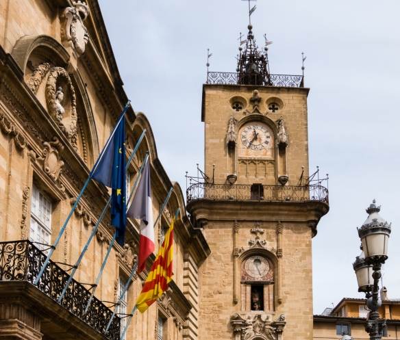 Built in 1510, the clock tower (Belfry) sits atop the old city wall in Place de l'Hotel de Ville (City Hall Plaza) -- adjacent to City Hall; the astronomic clock (showing citizens the seasons) was added in 1661; Aix-en-Provence, France