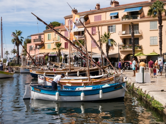 Colorful boats tied up along Quai Wilson at the inner harbor of Sanary-sur-Mer, France