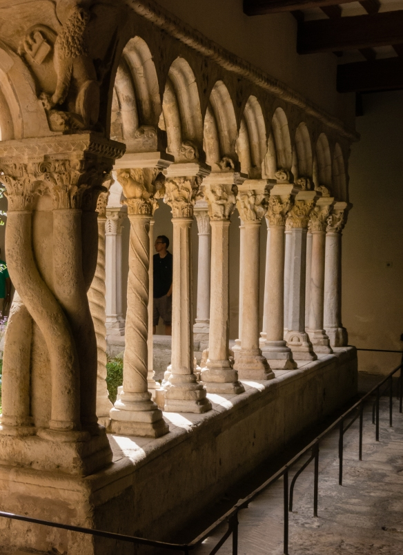 Columns leading into a cloister at one of many churches in old town, Aix-en-Provence, France