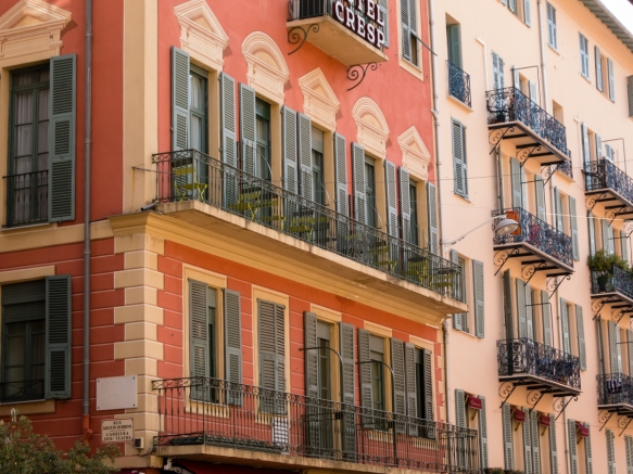 Hotel Cresp (on the left) and its neighbor building are typical of the French-style architecture (with wrought iron balconies), Nice, France