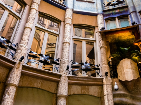Interior courtyard view of first floor (one level above the ground floor) apartments with unique Gaudí' window decorations (made of iron), Casa Milà (La Pedrera), Barcelona, Spain