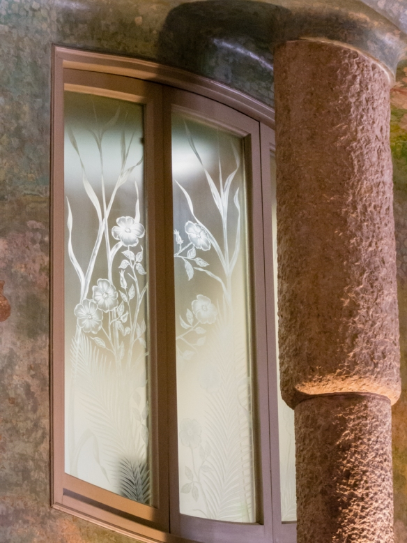 Interior courtyard window and column viewed from the entry foyer, Casa Milà (La Pedrera), Barcelona, Spain