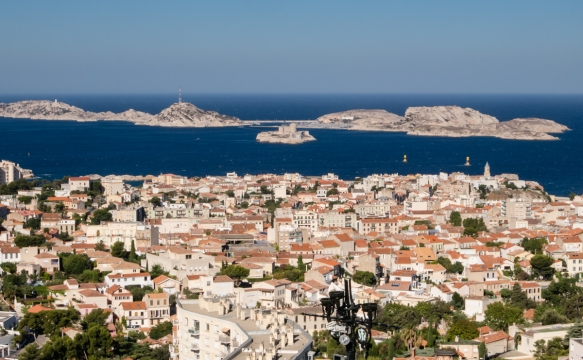 Les Iles (the Islands) with Chateau d'If (on the center island) lie just to the west of the city (as seen from Basilique Notre-Dame da la Garde (Our Lady of the Guard Basilica) which sits atop a hill); Marseille, France
