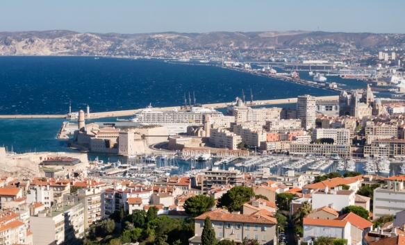 Our ship docked in Marseille, France, with the Bay of Marseille in the background and Vieux Port (Old Port) in the foreground in the center of the Le Panier District (old town)