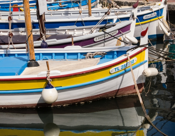 Picturesque small, colorful boats in the harbor of Sanary-sur-Mer, France