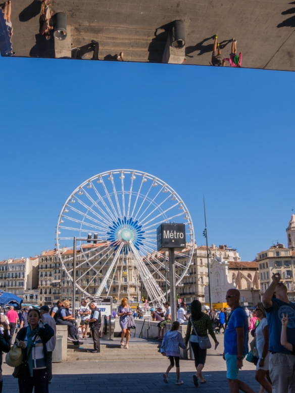 The Ferris wheel at Vieux Port (Old Port) and Norman Foster's polished steel Vieux Port Pavillion, Marseille, France