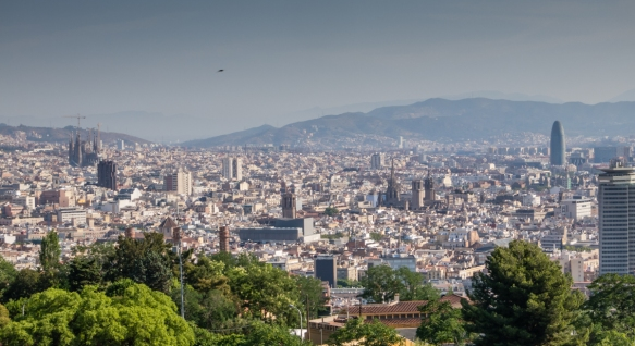 "The heart of Barcelona, Spain, with La Sagrada Familia (Gaudi's famous, unfinished Church of the Holy Family) (left), the Cathedral Basilica Metropolitana de Barcelona (center-right) and the Foster (English)-designed ""egg"" office building"
