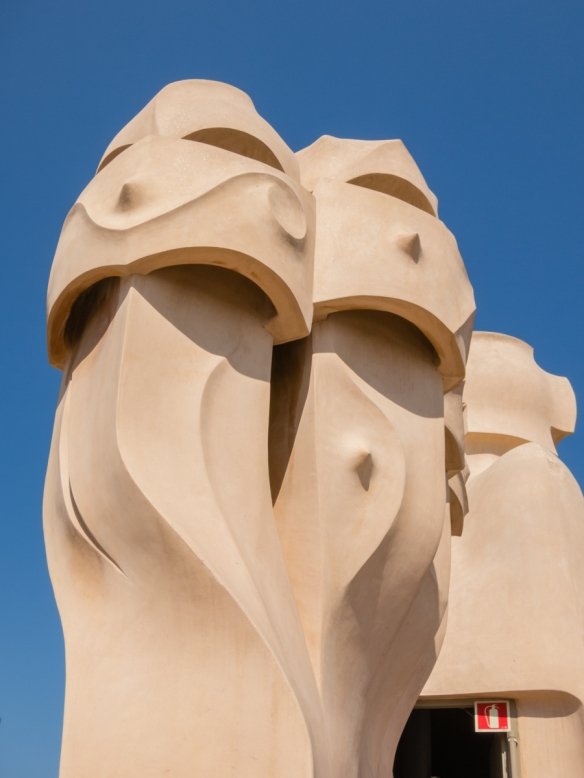 The undulating forms and columns on the roof are in keeping with the main facade, Casa Milà (La Pedrera), Barcelona, Spain