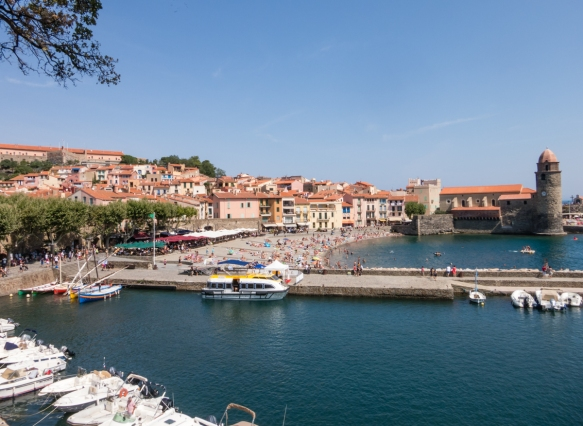 The Vieux Quartier du Moure (Old Quarter) of Collioure, France, looking north up the Plage Boramar (Boramar Beach) to the Eglise Notre Dame des Anges (Our Lady of the Angels Church)