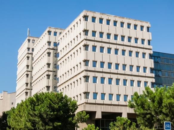This modern office building offers quite a contrast to the classical French architecture [see the above photograph] in downtown Marseille, France