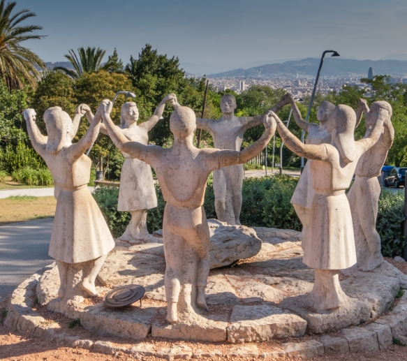 Traditional, 500+ year old Catalan dance of celebration – statue in Parc de Mont Juic, Barcelona, Spain