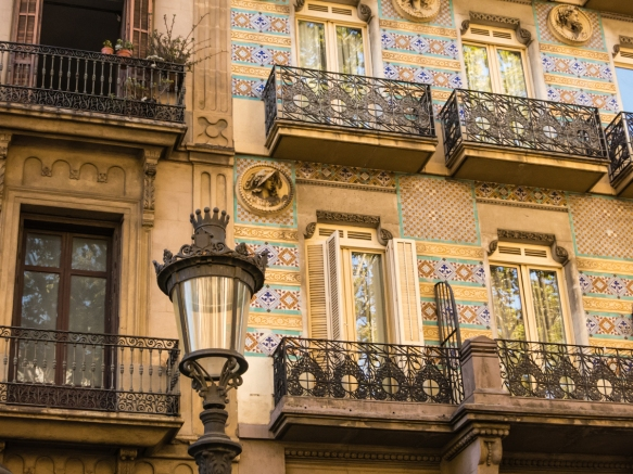 Typical 19th century residential facades on the apartments fronting the main thoroughfare and most famous street, Las Ramblas, in the city, Barcelona, Spain