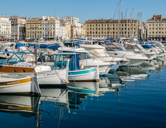 Vieux Port (Old Port), in the center of the Le Panier District (old town), remains a thriving harbor with 3,500 berths for fishing boats and yachts and is surrounded by an abundance of restaurants, bars and shops, Marseille, France