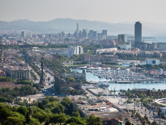 View from Parc de Mont Juic of historic Barcelona, Spain, the Port Vell waterfront and the 20th century high rise buildings, with the Monument Colon (Christopher Columbus column) on the left