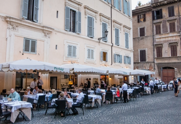 We had a delicious dinner at a trattoria favored by locals, Pierliugi, dining outside on the street, serenaded by local musicians and enjoying the view of the local neighborhood, Roma, Italy